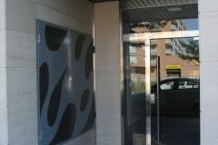 Puerta batiente de acero inoxidable