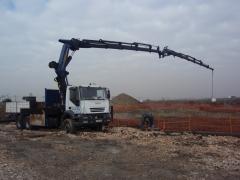 Pk 56002 con jib pj 125 trabajando al servicio de obra.