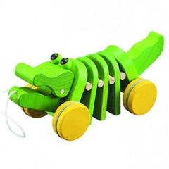 Juguetes de madera. cocodrilo bailarín de plan toys