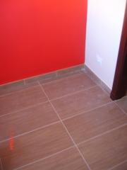 Colocaci�n de pavimento en una vivienda