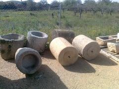Picas y rulos de piedra antiguos