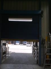 Reparaci�n  de puerta r�pida de pvc.