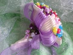 Un bouquet de alfileres realizado por encargo en tonos malvas