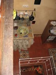 Foto del Estudio cocina y salon desde altillo habitación