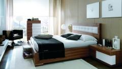 Habitacion con dormitorio en color blanco y nogal