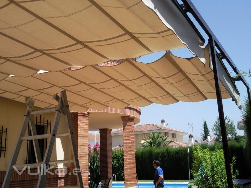Foto toldos de gu as y estructura lacada negro for Estructura de toldo