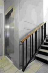 Ascensor por hueco de escalera inox.