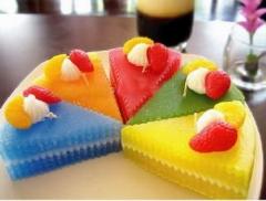 Vela en forma de porción de tarta