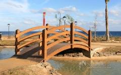 Puente curvo de madera urb. mar de  pulp�