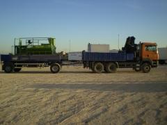 Camión grua con remolque
