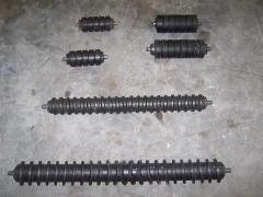 Rodillos con gomas (ovales, amortiguadores, helicoidales). para impactos o limpiezas de bandas.