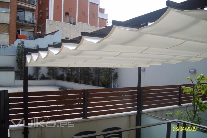 Foto toldos correderos con porteria de aluminio for Toldos de aluminio