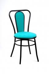 Silla mod. s-13. asiento y respaldo tapizados. pintura al horno en negro.