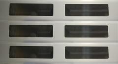 Muestra de lama enrollable de aluminio con ventanillos de metraquilato