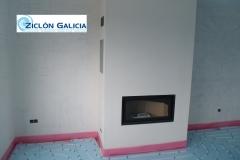 Instalación de suelo radiante en combinación con chimenea de leña con recuperador de calor