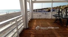 Terraza con tarima tratada en autoclave y sombraje en pvc microperforado. www.navarrolivier.com