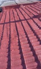 aislamiento de cubierta exterior con poliuretano y acabada con spr300 rojo