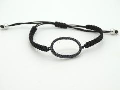 Pulsera ajustable de plata con macramé negro y pieza de circonitas negras. hecha a mano