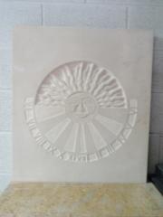 Reloj de sol en piedra arenisca
