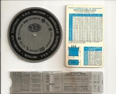 Antiguos utensilios de calculos electricos: tablas deslizantes y giratorias y calculo de condensadores gee.