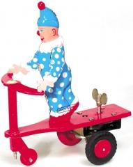 Payaso en patinete ( juguete de hojalata con mecanismo de cuerda.13cms ) www.juguetedehojalata.com