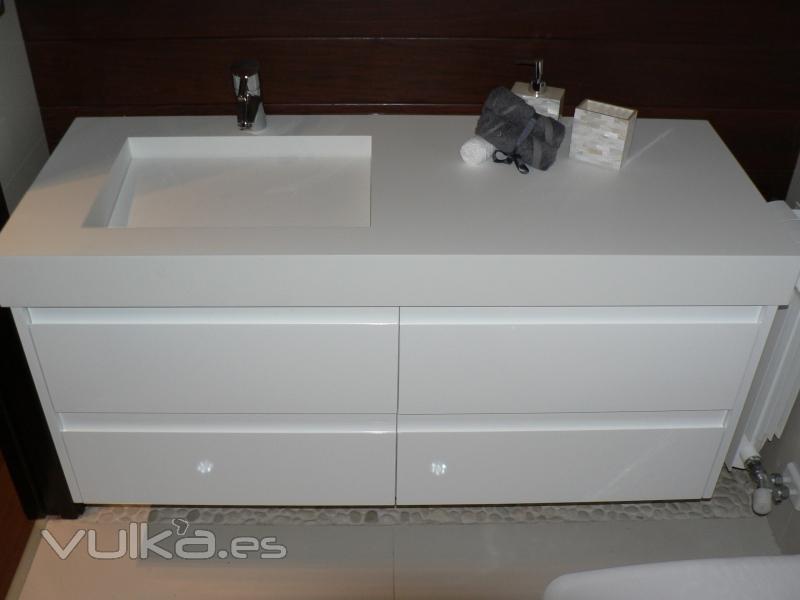 Foto mueble a medida con encimera en corian y madera lacada - Encimera corian ...