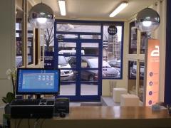 Zona de clientes de la boutique del planchado