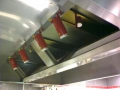 Detalle botes de aerosol para extinci�n autom�tica de incendios en campanas de cocinas.