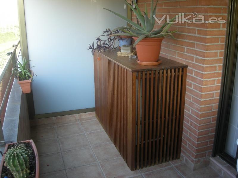 foto mueble exterior para tapar aire acond en madera