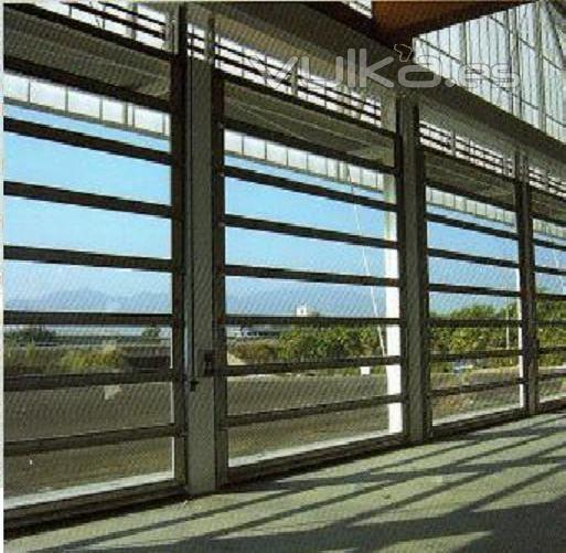 Foto puertas seccionales para talleres y naves industriales - Puertas para naves industriales ...