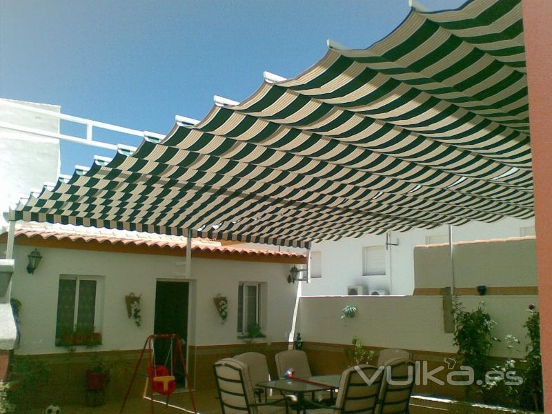 Foto toldo de palilleria de aluminio con estructura for Estructura de toldo