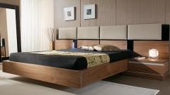 Cabezal con paneles tapizados y aro en chapa natural color nogal