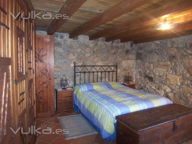 Foto dormitorio con paredes de piedra - Pared decorada con fotos ...