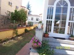 Vista jardin y porche
