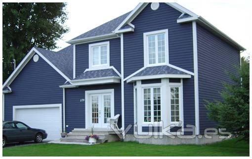 Foto casa de madera con revestimiento exterior en canexel - Casas de color azul ...