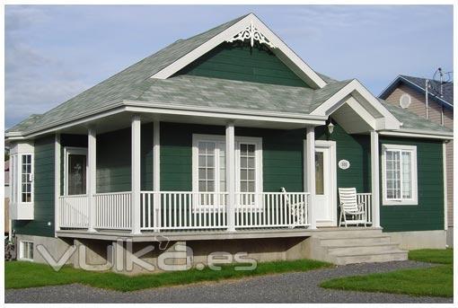 Foto casa de madera con revestimiento exterior en canexel - Casas color verde ...