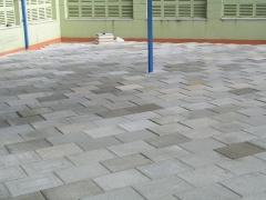 Terraza transitable terminada con baldosa filtrante, solado y aislamiento en una pieza.