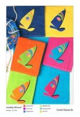 Toallas de playa bordadas, creart osona. un regalo original, una pieza artesanal y un complemento te