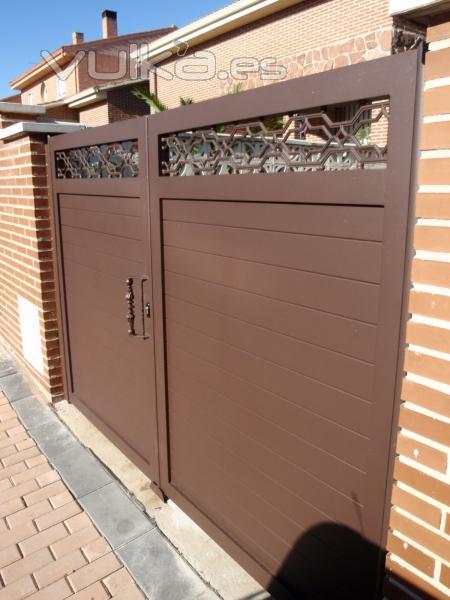 Aluminios polo madrid torres de la alameda c alberca 32 for Puertas de aluminio exterior precios