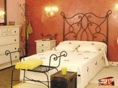 Dormitorio de forja granada